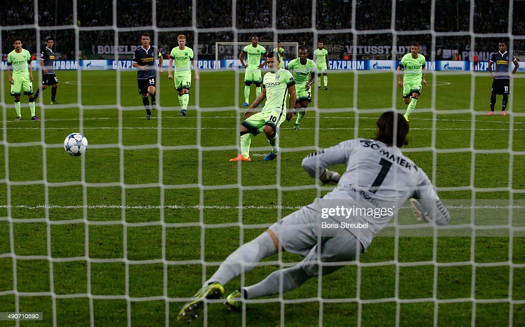 Sergio Aguero of Manchester City scores a penalty to his team's second goal against goalkeeper Yann Sommer of Borussia Monchengladbach during the UEFA Champions League Group D match between VfL Borussia Monchengladbach and Manchester City at the Borussia Park on September 30, 2015 in Moenchengladbach, Germany.