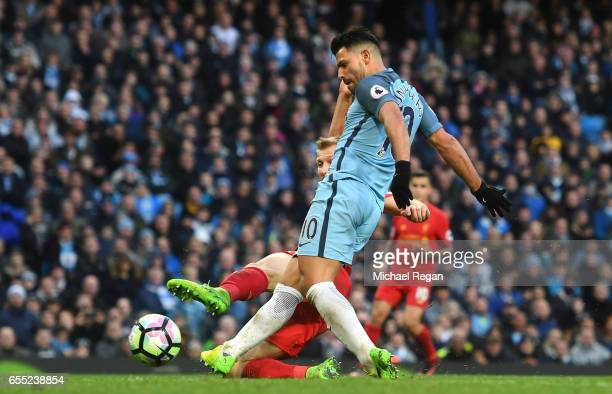Sergio Aguero of Manchester City scores his sides first goal during the Premier League match between Manchester City and Liverpool at Etihad Stadium...