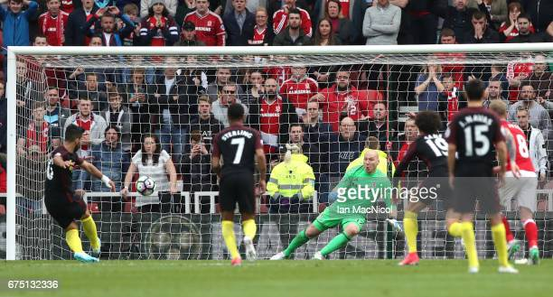 Sergio Aguero of Manchester City scores his sides first goal from the penalty spot during the Premier League match between Middlesbrough and...