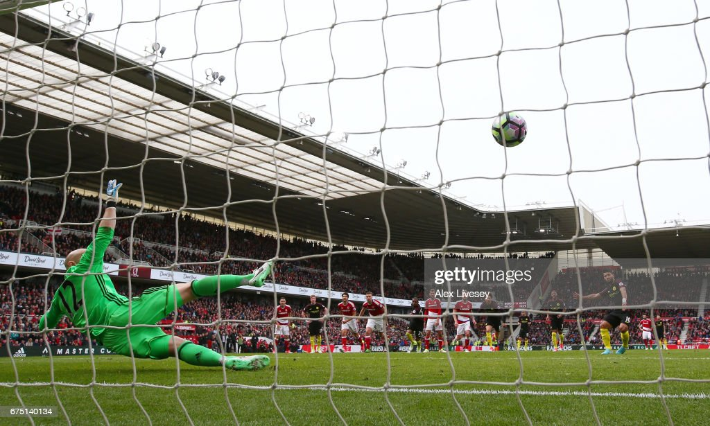 Sergio Aguero of Manchester City (R/obscure) scores his sides first goal from the penalty spot past Brad Guzan of Middlesbrough (L) during the Premier League match between Middlesbrough and Manchester City at the Riverside Stadium on April 30, 2017 in Middlesbrough, England.