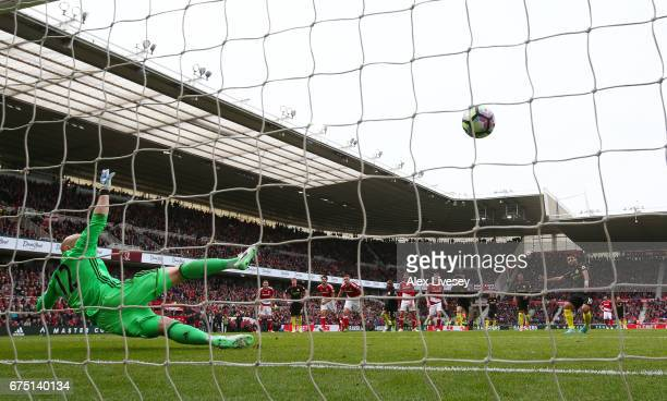 Sergio Aguero of Manchester City scores his sides first goal from the penalty spot past Brad Guzan of Middlesbrough during the Premier League match...