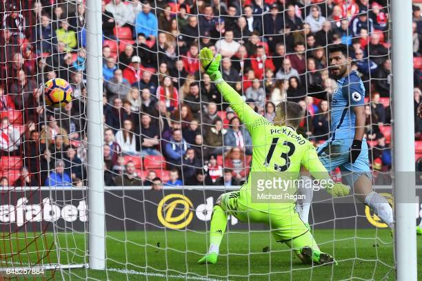 Sergio Aguero of Manchester City scores his sides first goal past Jordan Pickford of Sunderland during the Premier League match between Sunderland...
