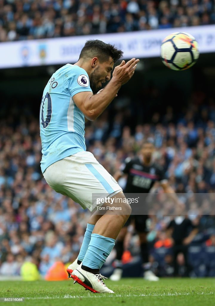 Sergio Aguero of Manchester City scores his sides fourth goal during the Premier League match between Manchester City and Crystal Palace at Etihad Stadium on September 23, 2017 in Manchester, England.