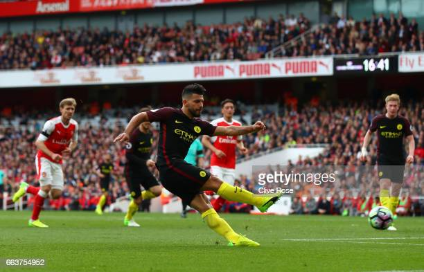 Sergio Aguero of Manchester City scores his sides second goal during the Premier League match between Arsenal and Manchester City at Emirates Stadium...