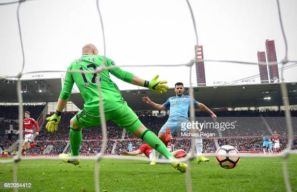 Sergio Aguero of Manchester City scores his sides second goal past Brad Guzan of Middlesbrough during The Emirates FA Cup QuarterFinal match between...