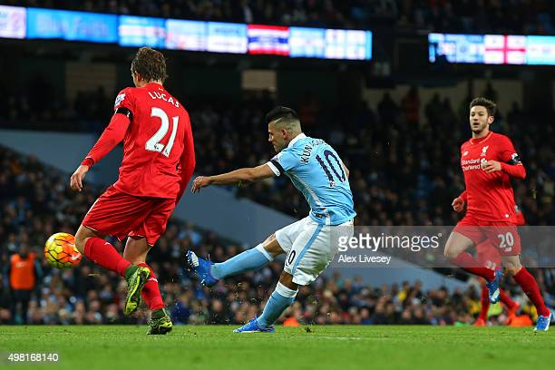 Sergio Aguero of Manchester City scores his team's first goal during the Barclays Premier League match between Manchester City and Liverpool at...