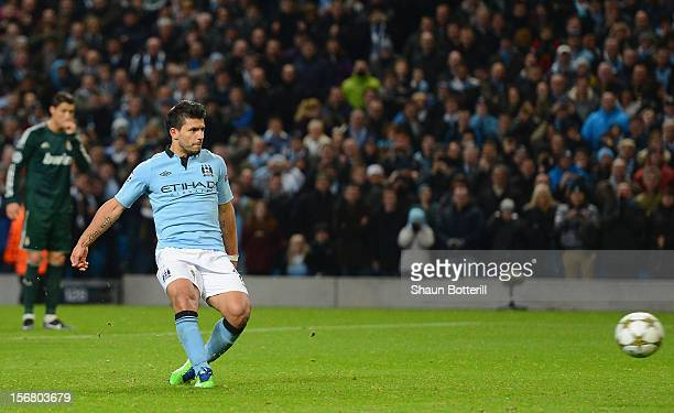 Sergio Aguero of Manchester City scores his team's first goal from a penalty to make the score 11 during the UEFA Champions League Group D match...