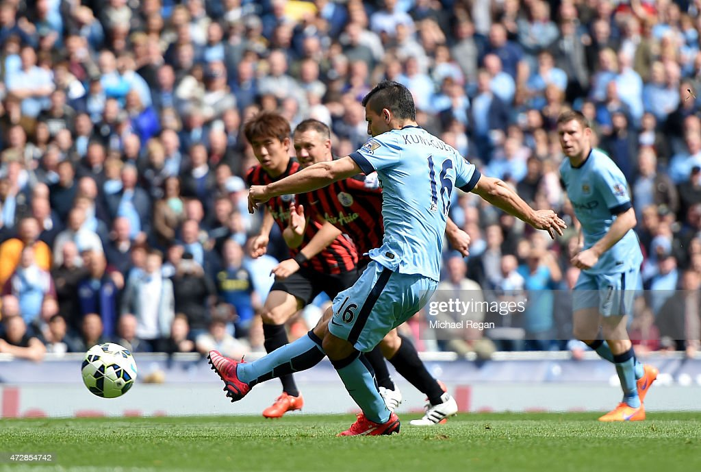 Sergio Aguero of Manchester City scores his team's fourth goal from the penalty spot during the Barclays Premier League match between Manchester City and Queens Park Rangers at the Etihad Stadium on May 10, 2015 in Manchester, England.