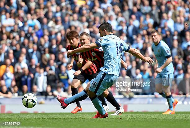 Sergio Aguero of Manchester City scores his team's fourth goal from the penalty spot during the Barclays Premier League match between Manchester City...