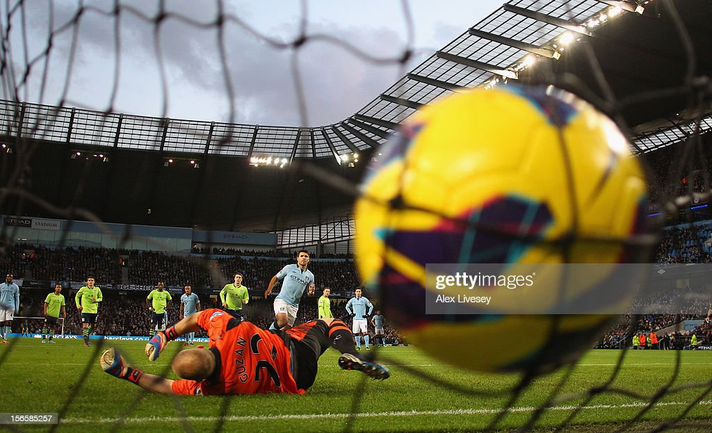 <a gi-track='captionPersonalityLinkClicked' href=/galleries/search?phrase=Sergio+Aguero&family=editorial&specificpeople=1100704 ng-click='$event.stopPropagation()'>Sergio Aguero</a> of Manchester City scores his team's second goal, from the penalty spot, to make the score 2-0 during the Barclays Premier League match between Manchester City and Aston Villa at the Etihad Stadium on November 17, 2012 in Manchester, England.