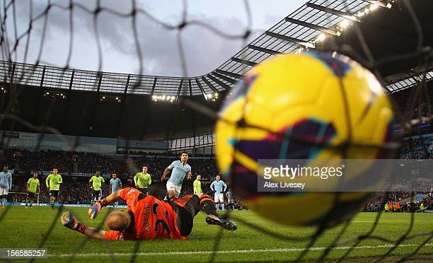 Sergio Aguero of Manchester City scores his team's second goal from the penalty spot to make the score 20 during the Barclays Premier League match...