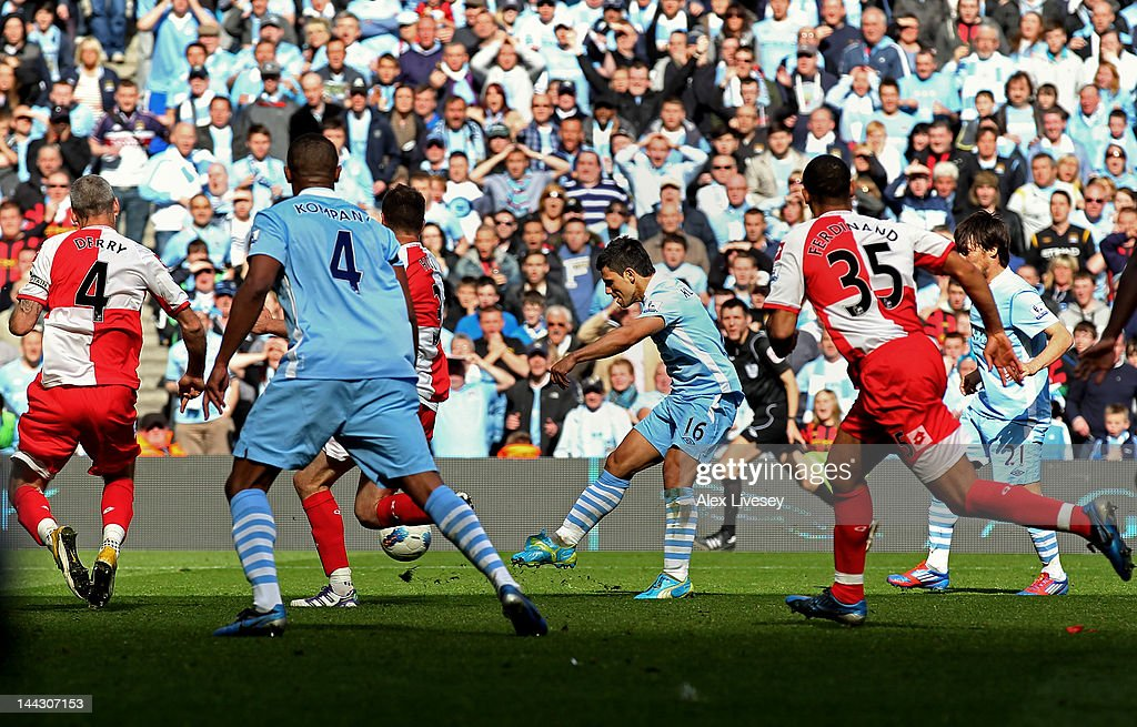 Sergio Aguero of Manchester City scores his team's third and matchwinning goal during the Barclays Premier League match between Manchester City and...