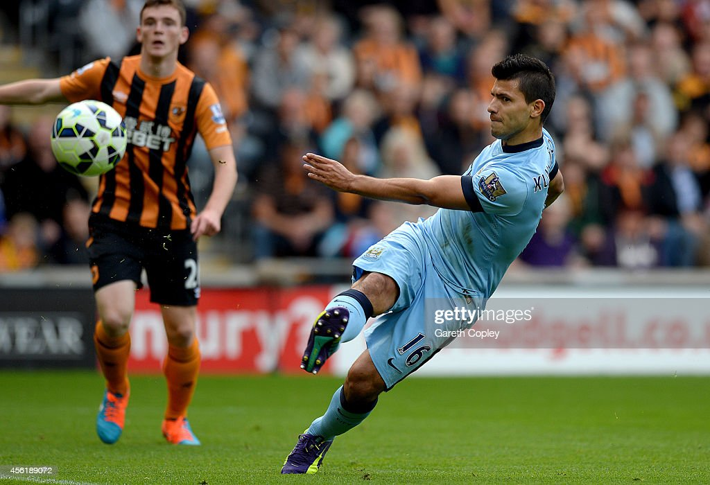 Sergio Aguero of Manchester City scores the opening goal during the Barclays Premier League match between Hull City and Manchester City at KC Stadium...