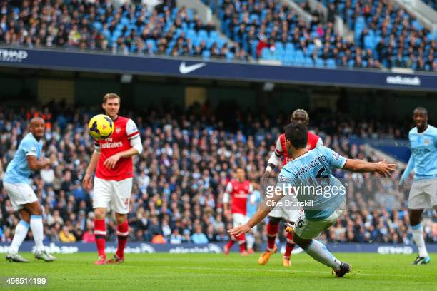 Sergio Aguero of Manchester City scores the opening goal during the Barclays Premier League match between Manchester City and Arsenal at Etihad...