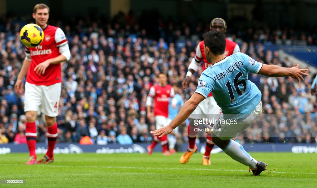 <a gi-track='captionPersonalityLinkClicked' href=/galleries/search?phrase=Sergio+Aguero&family=editorial&specificpeople=1100704 ng-click='$event.stopPropagation()'>Sergio Aguero</a> of Manchester City scores the opening goal during the Barclays Premier League match between Manchester City and Arsenal at Etihad Stadium on December 14, 2013 in Manchester, England.