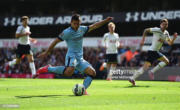 Sergio Aguero of Manchester City scores the opening goal during the Barclays Premier League match between Tottenham Hotspur and Manchester City at...