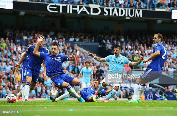 Sergio Aguero of Manchester City scores the opening goal during the Barclays Premier League match between Manchester City and Chelsea at the Etihad...