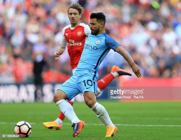 Sergio Aguero of Manchester City scores the opening goal during the Emirates FA Cup SemiFinal match between Arsenal and Manchester City at Wembley...
