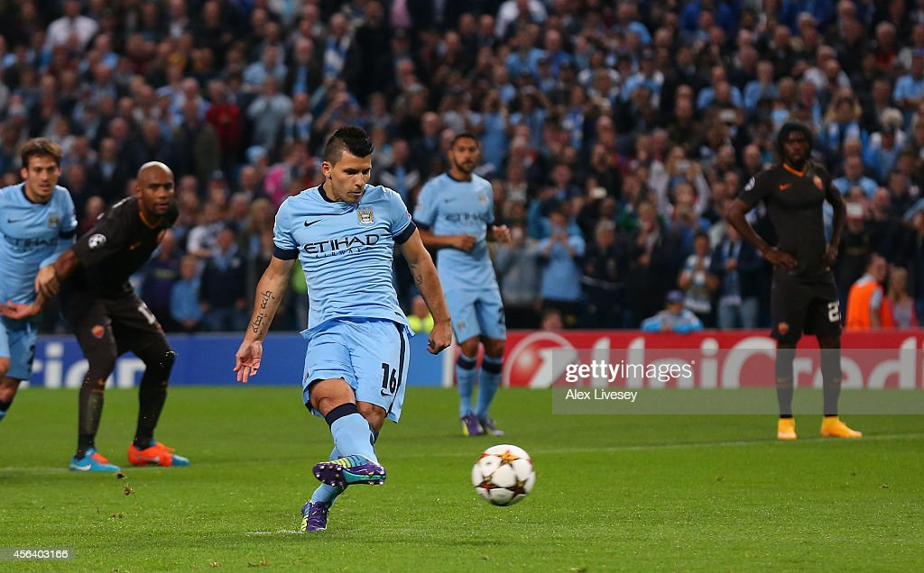 Sergio Aguero of Manchester City scores the opening goal from a penalty kick during the UEFA Champions League Group E match between Manchester City...