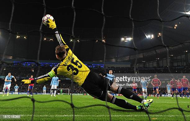 Sergio Aguero of Manchester City scores the opening goal from the penalty spot past Igor Akinfeev of CSKA during the UEFA Champions League Group D...