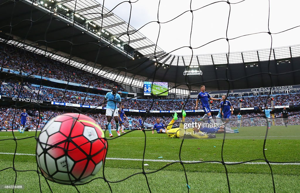Sergio Aguero of Manchester City scores the opening goal past Asmir Begovic of Chelsea during the Barclays Premier League match between Manchester City and Chelsea at the Etihad Stadium on August 16, 2015 in Manchester, England.