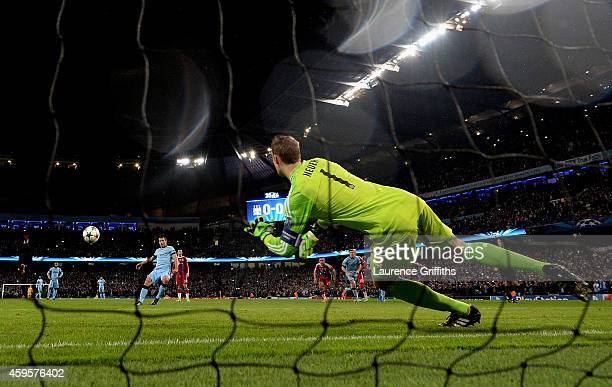 Sergio Aguero of Manchester City scores the opening goal past goalkeeper Manuel Neuer of Bayern Muenchen from the penalty spot during the UEFA...