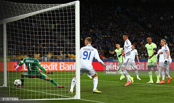 Sergio Aguero of Manchester City scores the opening goal past goalkeeper Oleksandr Shovkovskiy of Dynamo Kiev during the UEFA Champions League round...
