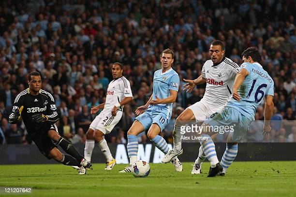 Sergio Aguero of Manchester City scores the second goal during the Barclays Premier League match between Manchester City and Swansea City at Etihad...