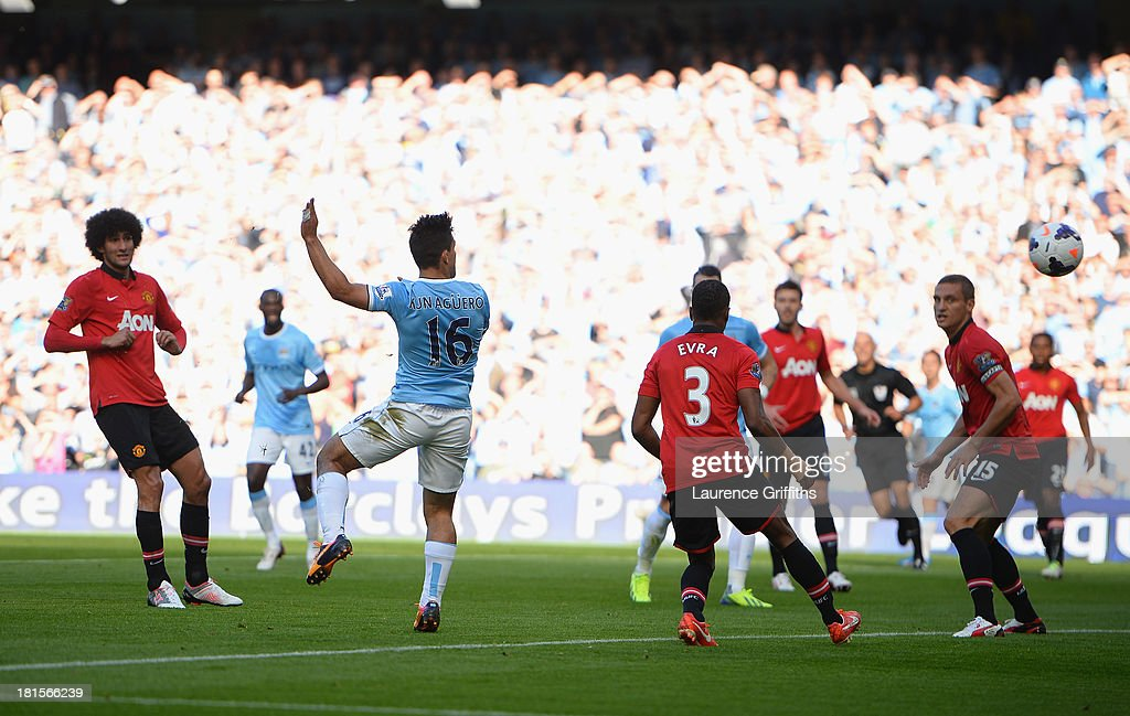 Sergio Aguero of Manchester City (16) scores their first goal during the Barclays Premier League match between Manchester City and Manchester United at the Etihad Stadium on September 22, 2013 in Manchester, England.