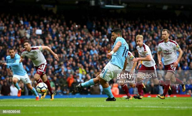 Sergio Aguero of Manchester City scores their first goal from the penalty spot during the Premier League match between Manchester City and Burnley at...
