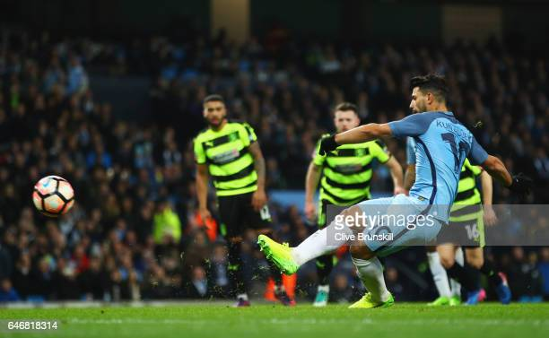 Sergio Aguero of Manchester City scores their second goal from a penalty during The Emirates FA Cup Fifth Round Replay match between Manchester City...