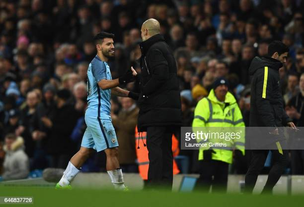 Sergio Aguero of Manchester City shakes hands with Josep Guardiola manager of Manchester City as he is substituted during The Emirates FA Cup Fifth...