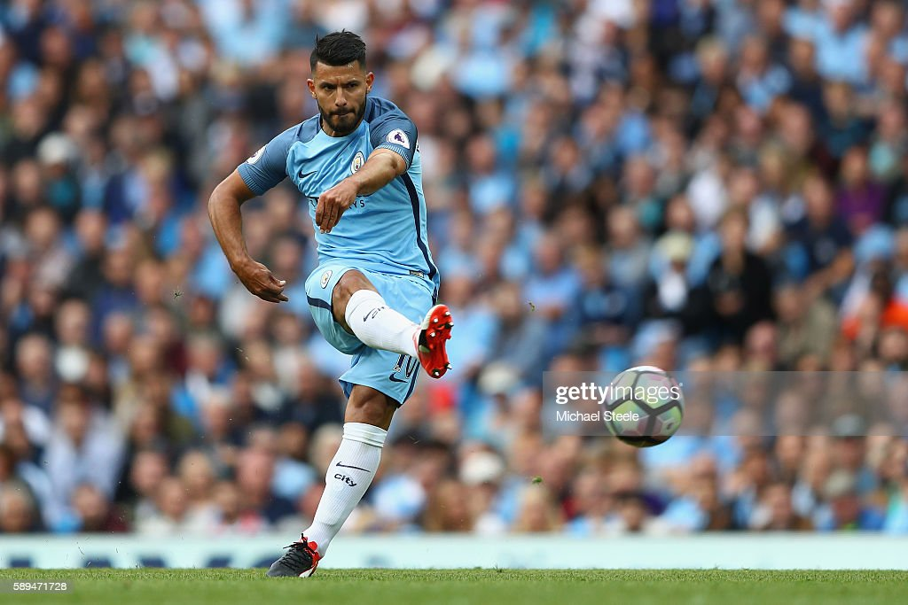 Sergio Aguero of Manchester City shoots at goal during the Premier League match between Manchester City and Sunderland at the Etihad Stadium on...