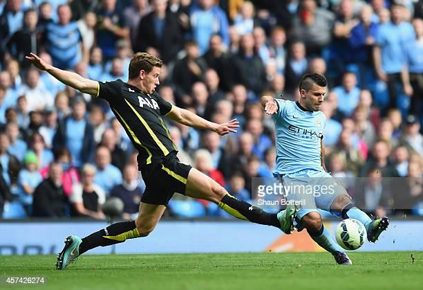 Sergio Aguero of Manchester City shoots past Jan Vertonghen of Tottenham Hotspur to score his fourth goal during the Barclays Premier League match...