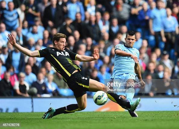 Sergio Aguero of Manchester City shoots past Jan Vertonghen of Tottenham Hotspur to score his fourth goal during the Barclays Premier League match...