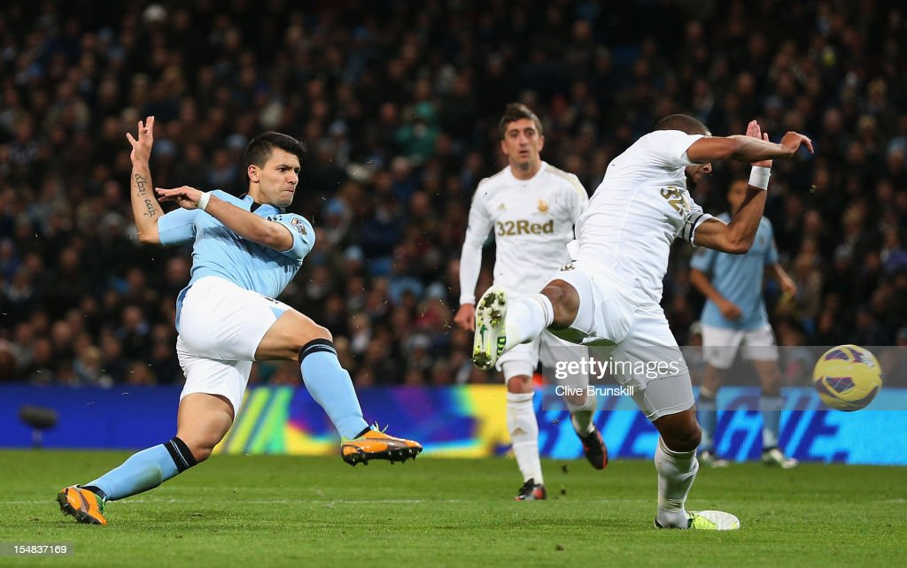 <a gi-track='captionPersonalityLinkClicked' href=/galleries/search?phrase=Sergio+Aguero&family=editorial&specificpeople=1100704 ng-click='$event.stopPropagation()'>Sergio Aguero</a> of Manchester City shoots towards Ashley Williams of Swansea City during the Barclays Premier League match between Manchester City and Swansea City at the Etihad Stadium on October 27, 2012 in Manchester, England.