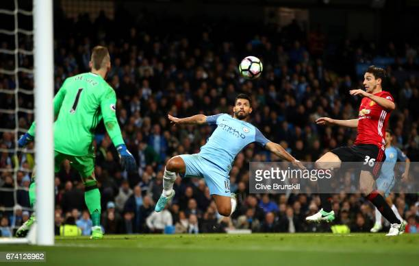 Sergio Aguero of Manchester City stretches for the ball during the Premier League match between Manchester City and Manchester United at Etihad...