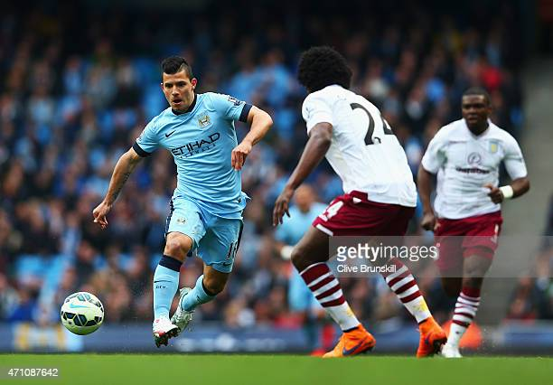 Sergio Aguero of Manchester City takes on Carlos Sanchez of Aston Villa during the Barclays Premier League match between Manchester City and Aston...