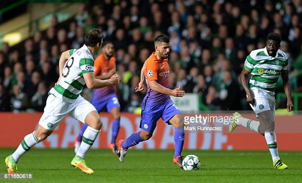 Sergio Aguero of Manchester City takes on Erik Sviatchenko and Kolo Toure of Celtic during the UEFA Champions League match between Celtic FC and...