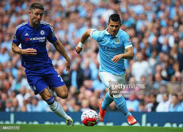 Sergio Aguero of Manchester City takes on Gary Cahill of Chelsea during the Barclays Premier League match between Manchester City and Chelsea at the...