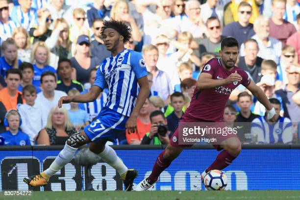 Sergio Aguero of Manchester City takes the ball past Isaiah Brown of Brighton and Hove Albion during the Premier League match between Brighton and...