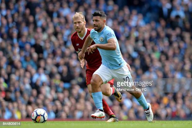 Sergio Aguero of Manchester City takes the ball past Ragnar Klavan of Liverpool during the Premier League match between Manchester City and Liverpool...