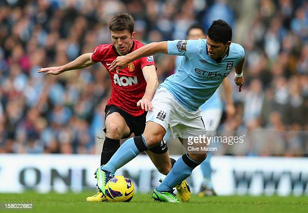 Sergio Aguero of Manchester City tangles with Michael Carrick of Manchester United during the Barclays Premier League match between Manchester City...