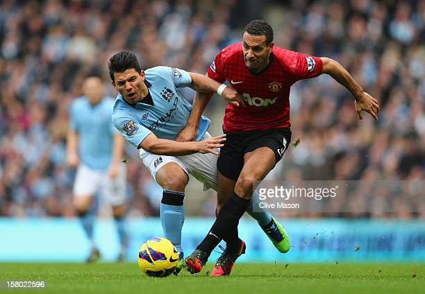 Sergio Aguero of Manchester City tangles with Rio Ferdinand of Manchester United during the Barclays Premier League match between Manchester City and...