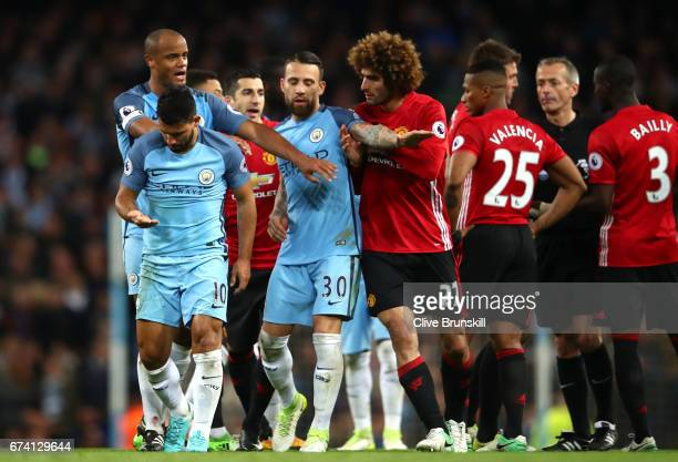 Sergio Aguero of Manchester City walks away following an incident with Marouane Fellaini of Manchester United during the Premier League match between...