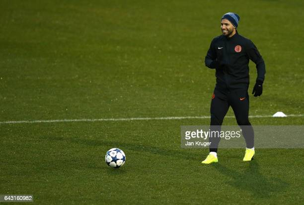 Sergio Aguero of Manchester City warms up during a Manchester City training session and press conference ahead of their UEFA Champions League Round...