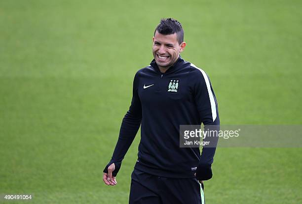 Sergio Aguero smiles during a Manchester City training session ahead of their Champions League fixture against Borussia Moenchengladbach at City...