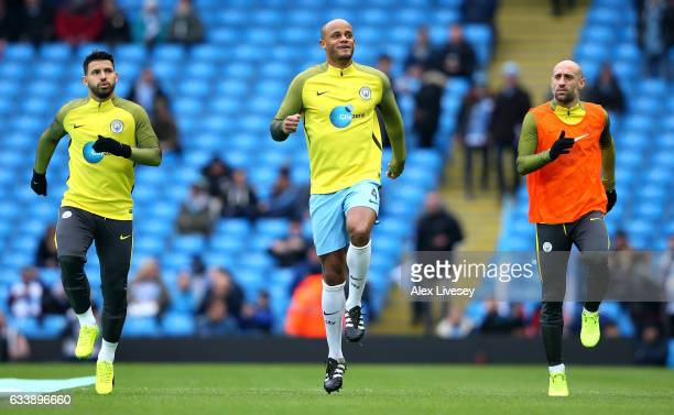 Sergio Aguero Vincent Kompany and Paulo Zabaleta of Manchester City warm up prior to the Premier League match between Manchester City and Swansea...