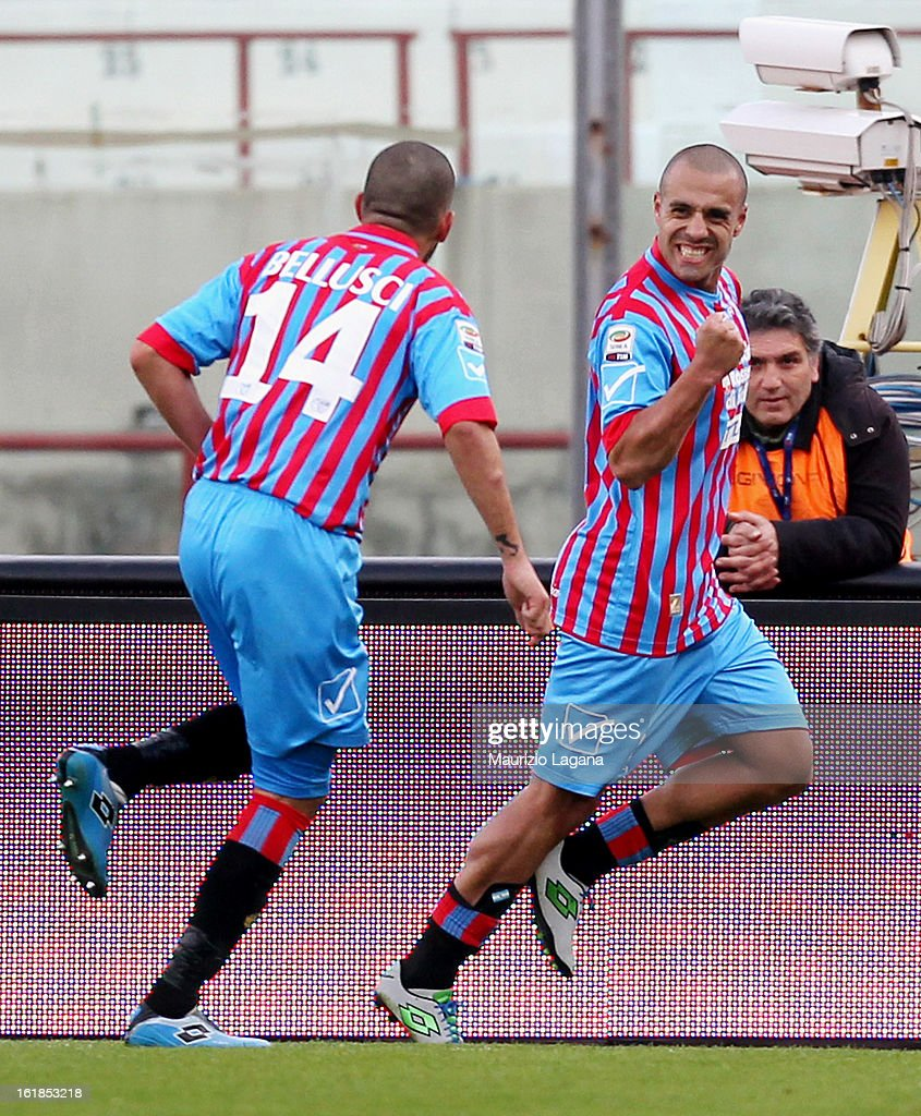 Sergio Almiron (R) and Giuseppe Bellusci of Catania celebrate the opening goal during the Serie A match between Calcio Catania and Bologna FC at Stadio Angelo Massimino on February 17, 2013 in Catania, Italy.