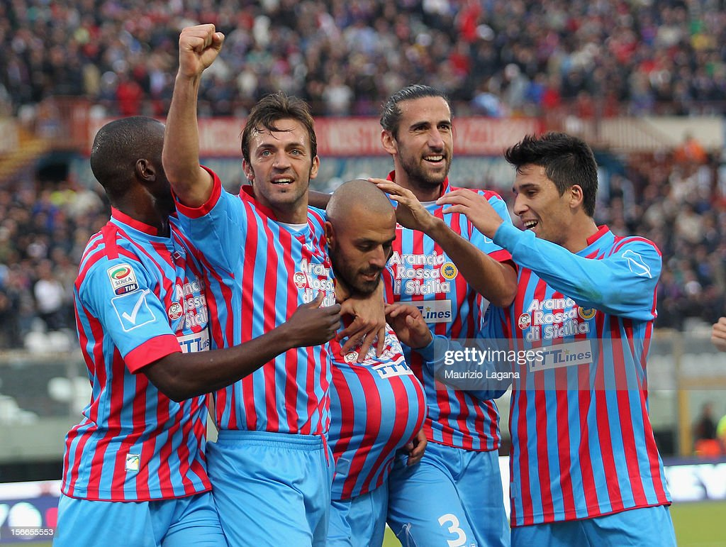 Sergio Almiron of Catania celebrates after scoring his team's opening goal during the Serie A match between Calcio Catania and AC Chievo Verona at...